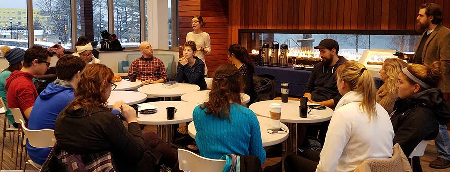 Students and faculty sit around a fire and talk about death at a recent Death Cafe event